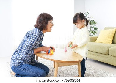 Child playing a game with grandmother