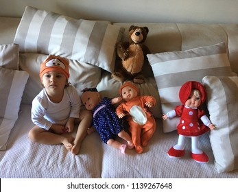 Child playing with his dolls, teddy bear and  and Masha. Masha and the Bear.