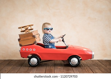 Child playing at home. Summer vacation and travel concept
