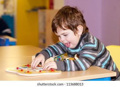 Child playing at kindergarten