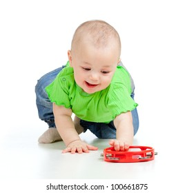 Child playing with musical toy. Isolated on white background