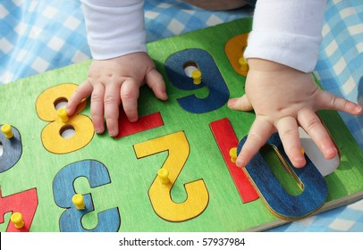 a child playing with a number puzzle