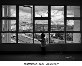 A child playing in an old abandoned factory alone