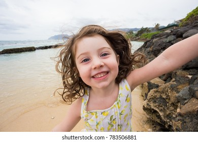 Child Playing on Beach in Oahu Hawaii