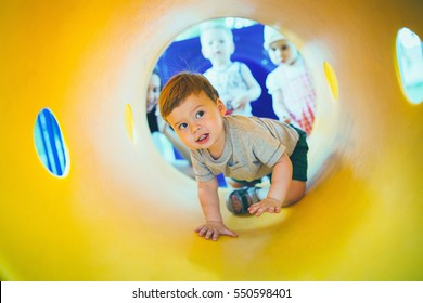 the child playing on the color playground