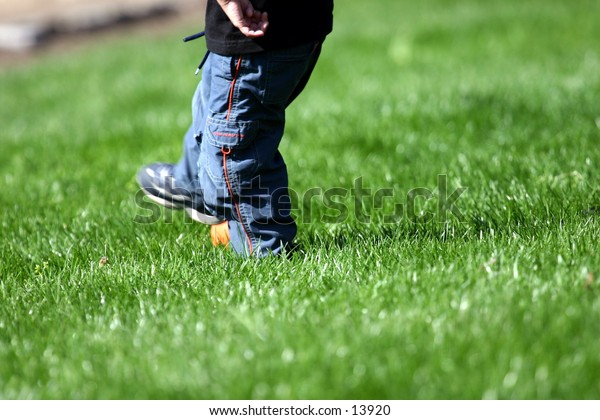 child playing on lawn