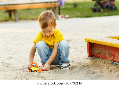Child playing on playground summer cheerful activity daycare.