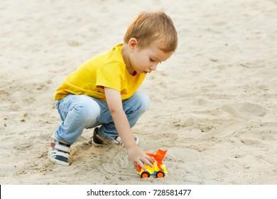 Child playing on playground summer cheerful activity happy.