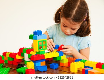 Child playing with plastic construction
