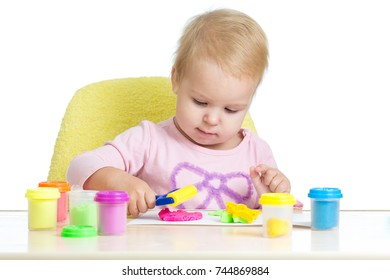 Child playing with plasticine. Isolated on white background.