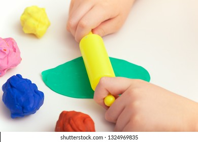 Child Playing Playdough. Close up.