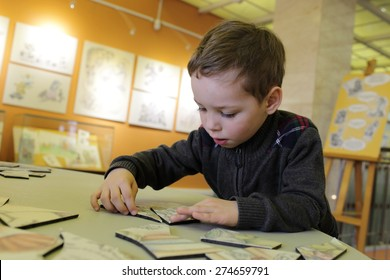Child playing with puzzle in the classroom