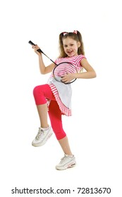 a child playing a racket for a badminton