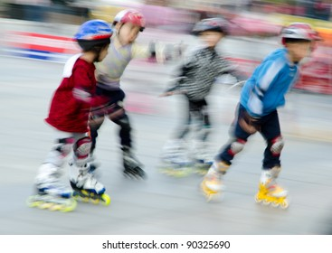 child playing rollerblade blur motion