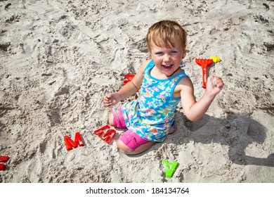 Child playing with sand on the playground