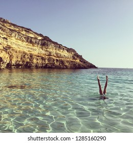 Child playing in the sea, Lampedusa, Sicilia, Italy.