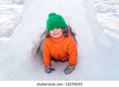 child playing in snow castle