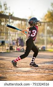 Child playing softball or baseball game