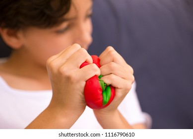 "Child playing squeezing a soft toy ""squishy"""