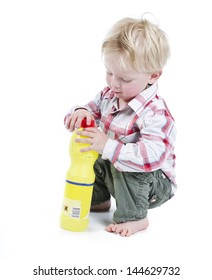 Child playing with toxic cleaner