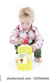 Child playing with toxic cleaners