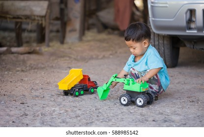 Child playing a toy backhoe.