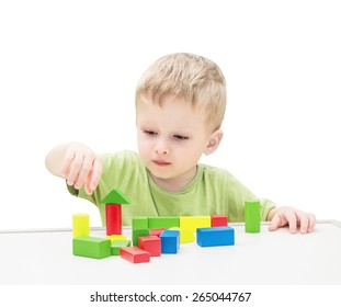 Child Playing Toys Blocks. Isolated White Background.