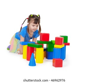 Child playing with toys isolated on white background