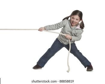 child playing tug of war