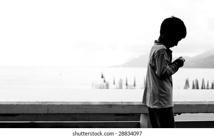 A child playing and walking along the seaside