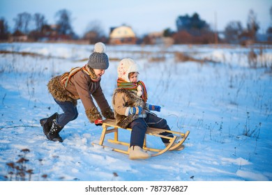 The Child playing in winter a outdoors.