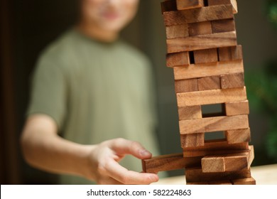 A child playing wood blocks stack game, learning and development background concept