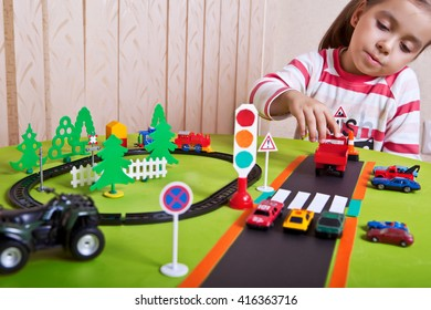 A child plays in the automotive and railway.