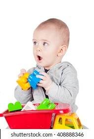 child plays with plastic constructor on white background