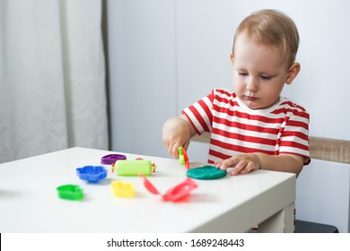 child plays with plasticine. motor development