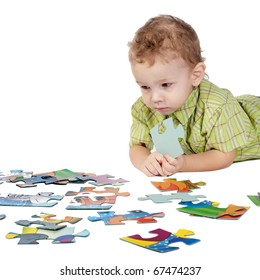 child plays with puzzles