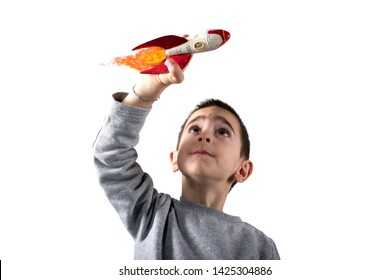 Child plays with a rocket. Concept of imagination. Isolated on white background