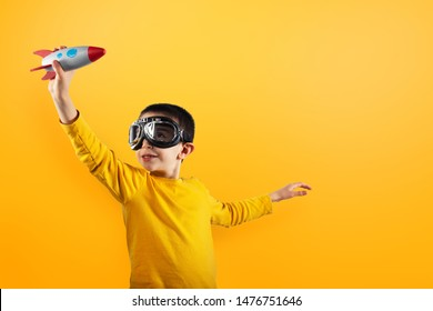 Child plays with a rocket. Concept of imagination.
