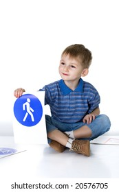 Child plays with traffic signs