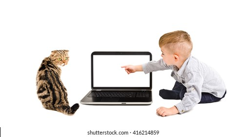 Child points finger at the screen of laptop sitting with a cat isolated on a white background