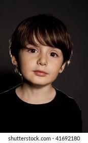 child portrait close up over black bg