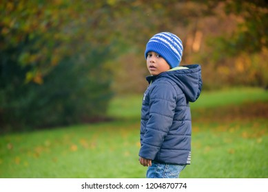 A child portrait outdoors in fall