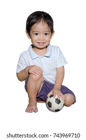 Child Portrait Sit On Floor And Hold Small Football On Left Hand Side On White Background
