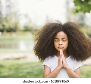 child praying. girl kid prays. Gesture of faith.Hands folded in prayer concept for faith,spirituality and religion