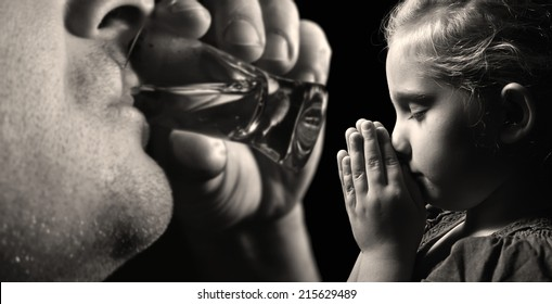 Child prays that father stopped drinking alcohol. MANY OTHER PHOTOS FROM THIS SERIES IN MY PORTFOLIO.