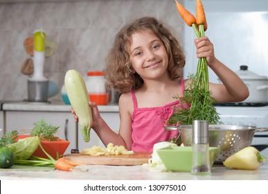 child  preparing healthy food vegetable salad