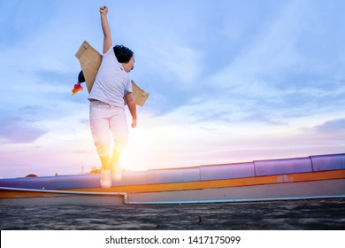 Child pretend to be businessman. Kid playing at home. Imagination, idea and creative concept. The girl who has a year of swagger flying over the city at sunset, Business advantage.