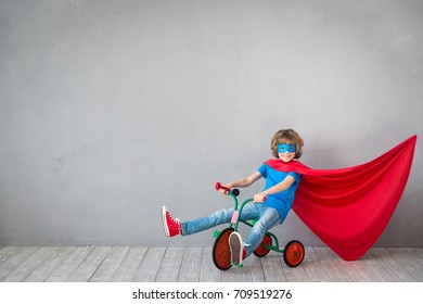 Child pretend to be superhero. Child playing at home. Super hero kid. Success, creative and imagination concept