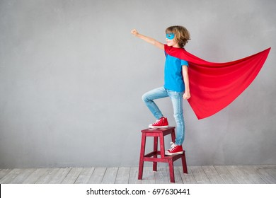 Child pretend to be superhero. Super hero kid. Success, creative and imagination concept