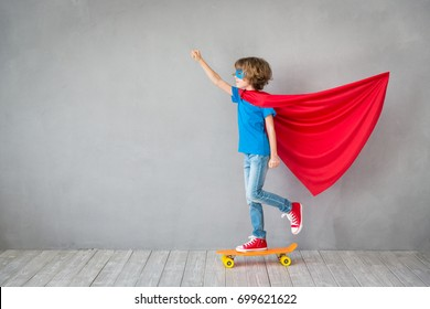 Child pretend to be superhero. Super hero kid. Child playing at home. Success, winner and imagination concept